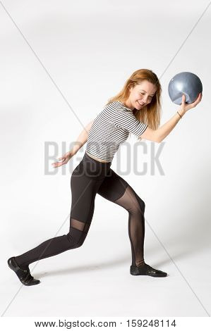Athletic Woman In Sportswear Fooling Around With The Ball, Pretending To Be A Statue Of Discus Throw