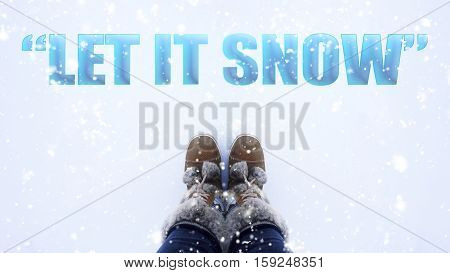 Let it snow word on snow background inspirational quote