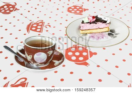 Breakfast with a cup of tea and cake on a plate