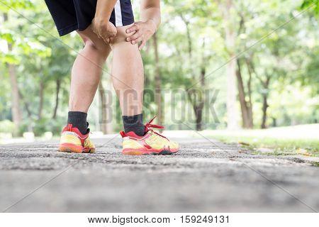 Sport injury. Hamstring tendons knee injury while jogging