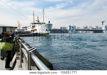 Istanbul Turkey - March 29 2013: Istanbul Ferries passenger movement. Istanbul Ferries (called vapur in Turkish) continue to serve as a key public transport link for many Thousands of commuters tourists and vehicles per day.