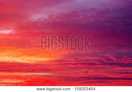 Beautiful apocalyptic fiery sunset sky as background.