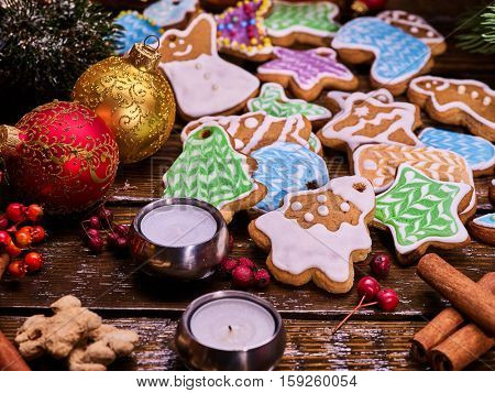 Christmas gingerbread cookies on woden table and candels.