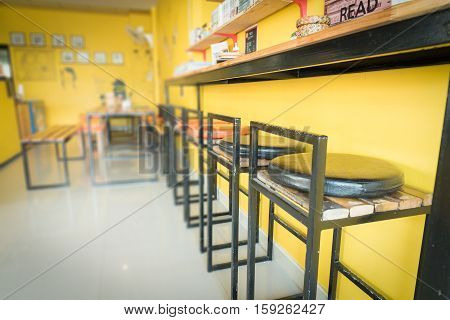 empty indoor bar wooden stool standing next to bar table