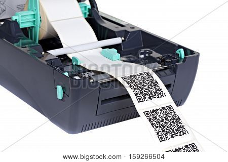 Barcode Label Printer isolated on white background. Studio short. Dummy barcode contains no information.