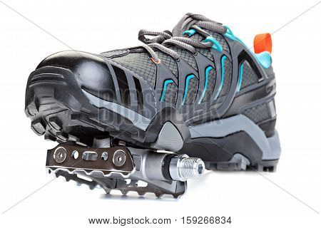 Closeup of cycling shoes with pedal attached to the sole isolated on white background.