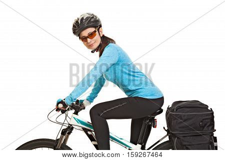 Female mtb cyclist with saddlebag looking at the camera and smiling isolated on white background. Studio shot. Rear view.