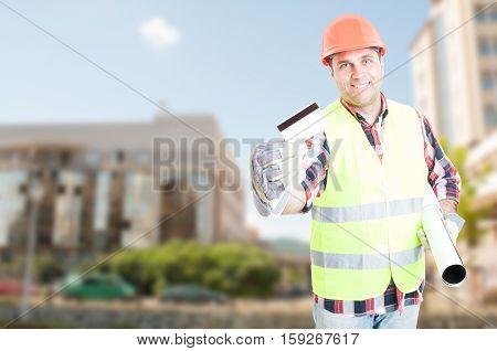 Construction Engineer Showing Debit Card