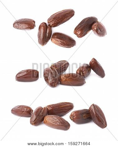 Pile of dark date fruits over isolated white background surface