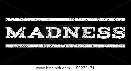 Madness watermark stamp. Text tag between horizontal parallel lines with grunge design style. Rubber seal white stamp with unclean texture. Vector ink imprint on a black background.