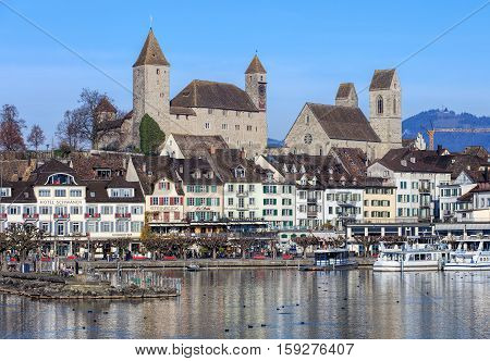 Rapperswil, Switzerland - 30 November, 2016: buildings in the historic part of the town, people on the embankment of Lake Zurich. Rapperswil is a part of the municipality of Rapperswil-Jona in the Swiss Canton of St. Gallen.