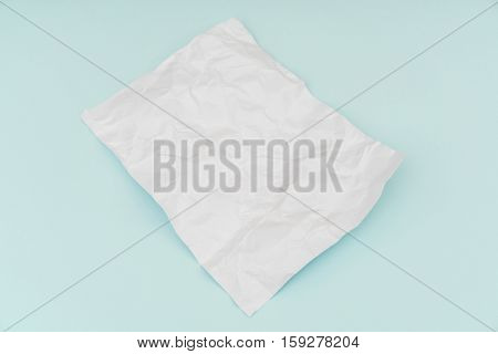 Wrinkled paper  flyer poster, brochure mockup,A4, US-Letter, on blue background