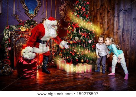 Miracles happen. Small children saw Santa Claus on Christmas eve. Christmas concept.