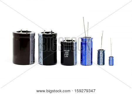 Group of capacitors different sizes isolated on white background.