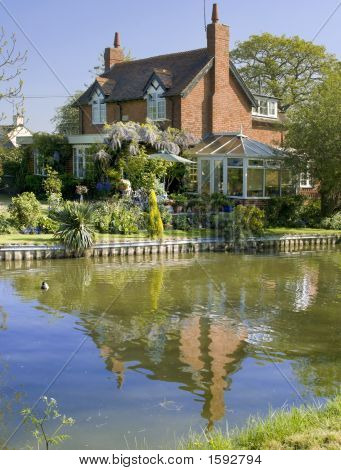 Cottage House Alongside Canal