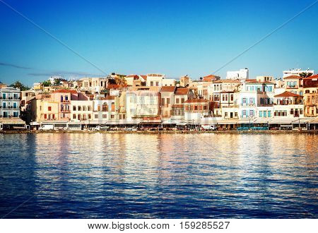 waterfront of Chania bay at sunny summer day, Crete, Greece, retro toned