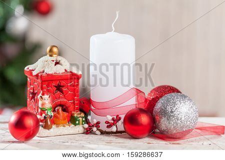 Christmas decoration with candle and fir branches