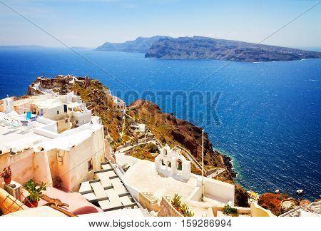 lanscape of Oia with volcano caldera and Aegan sea, beautiful details of Santorini island, Greece, retro toned