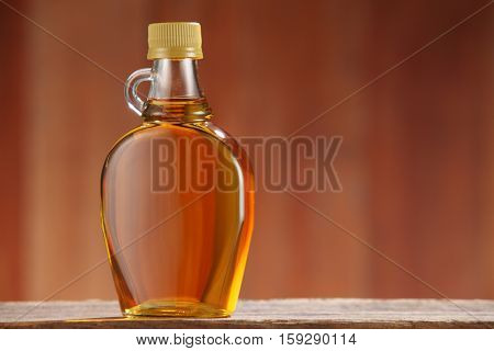 bottle of agave syrup on the wooden background