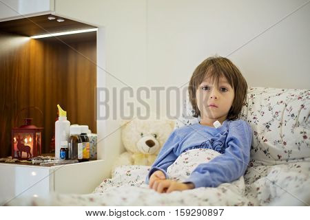 Cute Sick Child, Boy, Staying In Bed, Playing With Teddy Bear