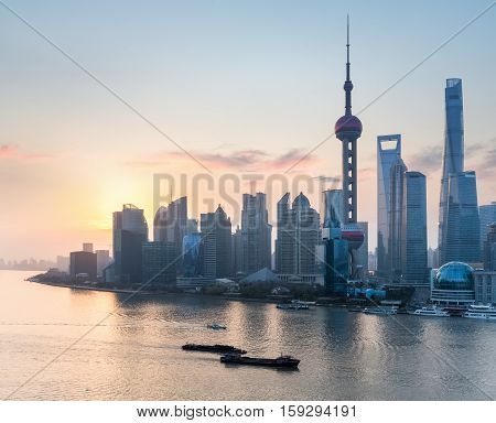 shanghai in sunrise lujiazui financial and trade zone skyline with rosy dawn