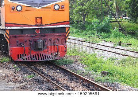 locomotive train running on rails station of in travel in Thailand
