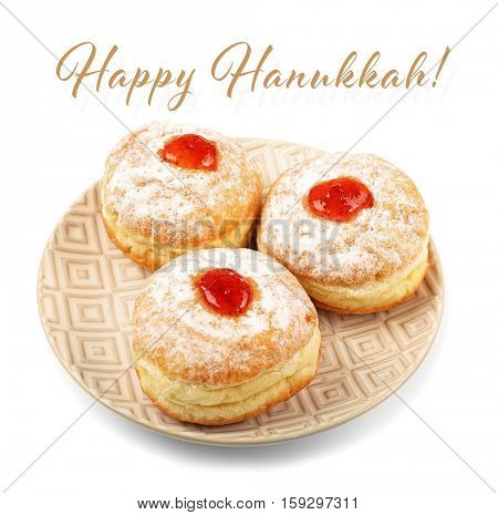 Plate with tasty donuts on white background. Hanukkah celebration concept. Text HAPPY HANUKKAH