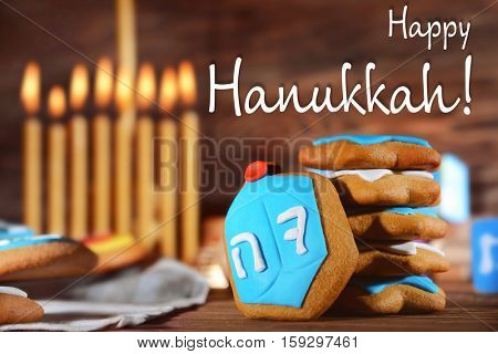 Tasty cookies for Hanukkah on wooden table, closeup. Hanukkah celebration concept. Text HAPPY HANUKKAH