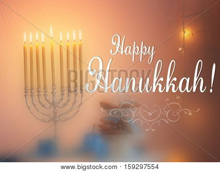 Menorah with candles for Hanukkah on table. Hanukkah celebration concept. Text HAPPY HANUKKAH