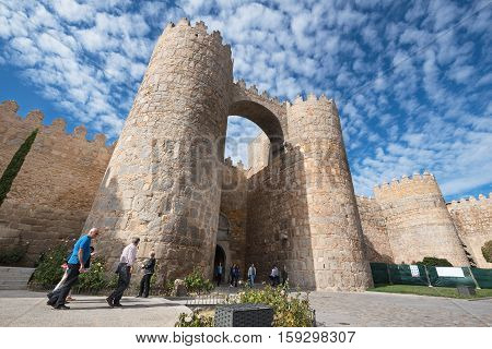 Avila Spain - October 27: Tourist visiting famous walls on October 27 2016 in the medieval city of Avila Spain.
