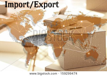 World map and text IMPORT/EXPORT on background. Cardboard boxes at storehouse. Wholesale and logistics concept.