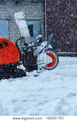 Cleaning Snow Machine Working During Snowing