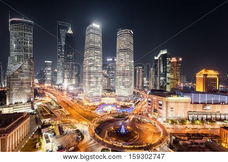 aerial view of the bustling metropolis and busy streets in shanghai at night