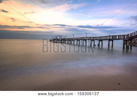 Summer Travel Vacation and Holiday concept - Wooden pier between sunset in Phuket Thailand