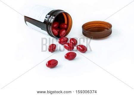 Red Pills And Medicine Bottle On White Background