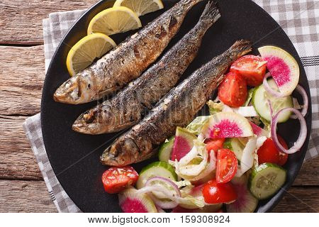 Mediterranean Food: Grilled Sardines With Fresh Vegetable Salad Close-up. Horizontal Top View