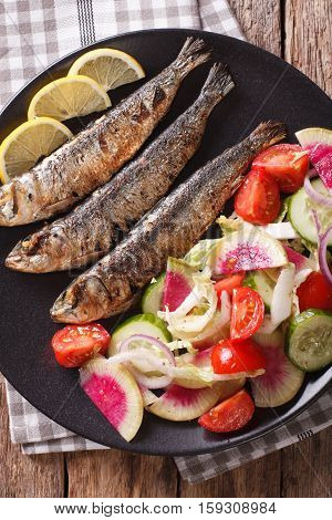 Mediterranean Food: Grilled Sardines With Fresh Vegetable Salad Close-up. Vertical Top View