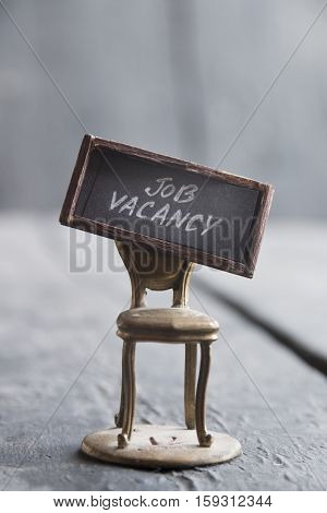 Job Vacancy text and a gold chair in vintage style