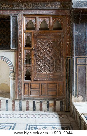 Cairo, Egypt - November 19, 2016: Embedded wooden ornate cupboard in one of the rooms of El Sehemy house an old Ottoman era house in Cairo originally built in 1648