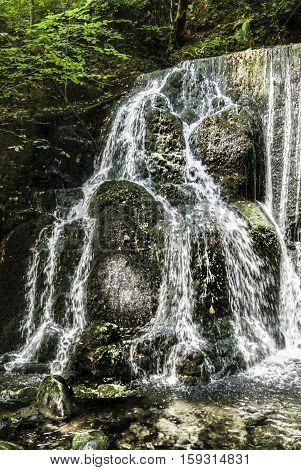 Waterfalls flowing well in Alva Glen Scotland
