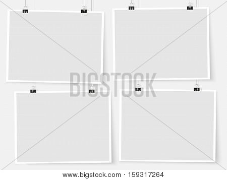 Posters on binder clips on the wall. Rectangular paper mockups set. Modern trendy horizontal framing for your design. Vector template for picture drawing quotes poster or photo.