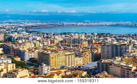 Urban panorama of Sardinia's capital Cagliari, view on Molentargius - Saline Regional Park, Italy