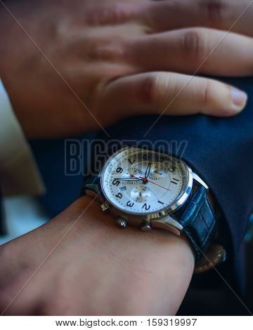 The classic man's watches on hand, close-up