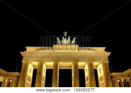 Brandenburg Gate at night in Berlin Germany.