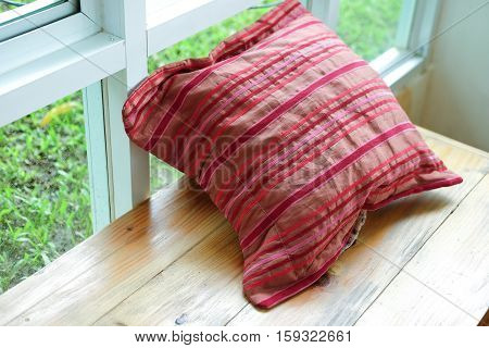 comfortable pillows on wood table, red pillow