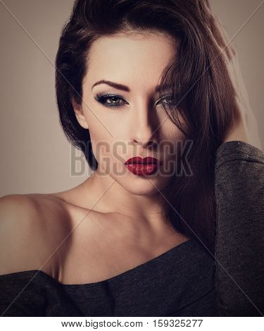 Beautiful Sexy Makeup Woman With Red Lipstick And Long Lashes Looking Hot. Toned Vintage Closeup Por