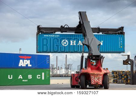 ROTTERDAM NETHERLANDS - SEP 6 2015: Mobile container handler in action at a container terminal in the Port of Rotterdam