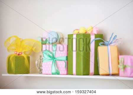 Closeup of colorful gifts box on shelf. Christmas or holyday decor