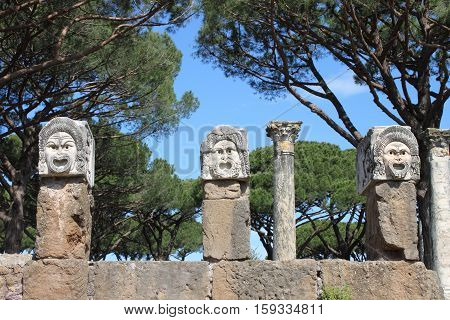Satiric masks in Ostia Antica the old Harbour of Rome, Italy