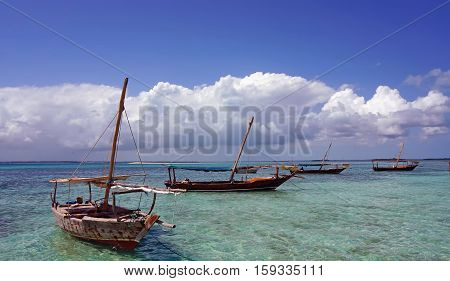 Traditional fishing boat standing on the shore in the clear water of the Indian Ocean. island of Madagascar Tanzania